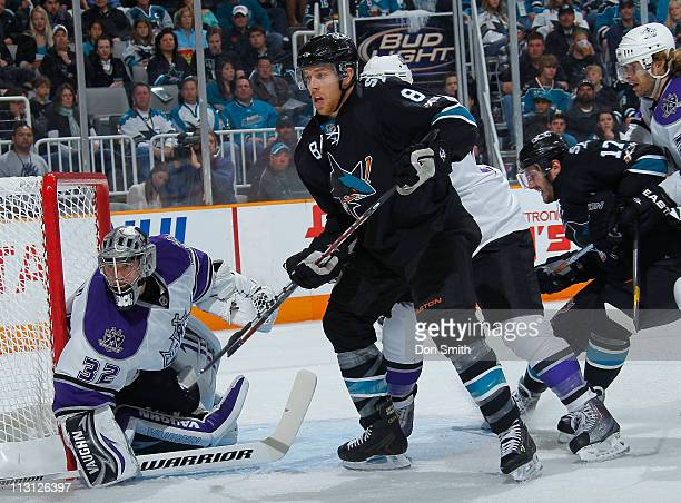 Joe Pavelski and Torrey Mitchell of the San Jose Sharks create traffic in front of the net against Jonathan Quick and Michal Handzus of the Los...