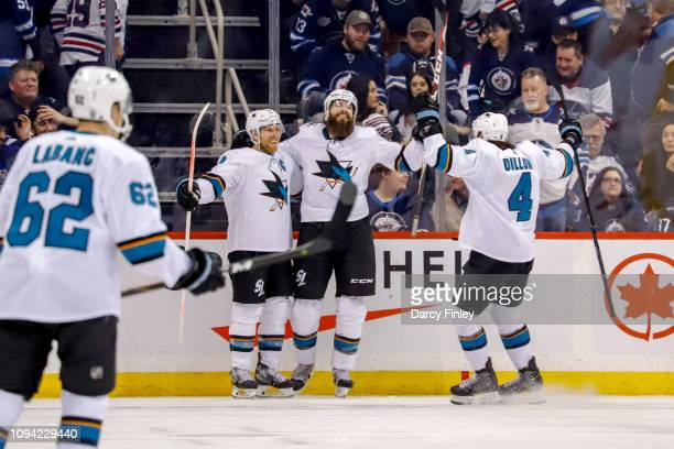Joe Pavelski Brent Burns and Brenden Dillon of the San Jose Sharks celebrate a 32 overtime victory over the Winnipeg Jets at the Bell MTS Place on...