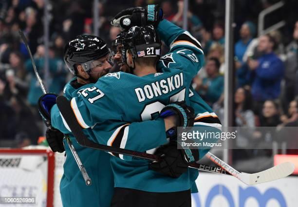 Joe Pavelski Evander Kane and Joonas Donskoi of the San Jose Sharks celebrate scoring a goal against the Calgary Flames at SAP Center on November 11...