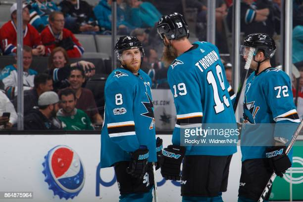 Joe Pavelski Joe Thornton and Tim Heed of the San Jose Sharks talk during the game against the San Jose Sharks at SAP Center on October 17 2017 in...