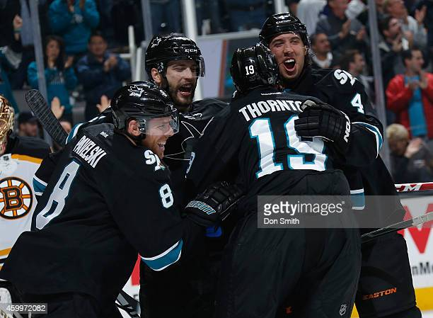 Joe Pavelski, Joe Thornton, Brent Burns and Brenden Dillon of the San Jose Sharks celebrate a goal against the Boston Bruins during an NHL game on...