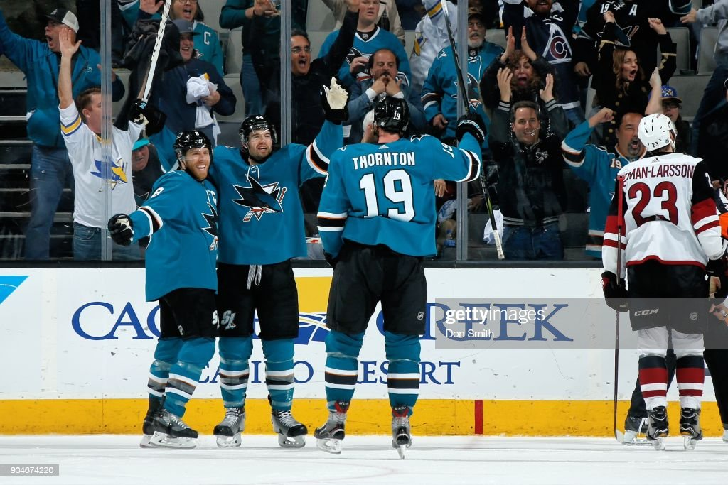 Joe Pavelski #8, Marc-Edouard Vlasic #44 and Joe Thornton #19 of the San Jose Sharks celebrate the Sharks win against the Arizona Coyotes at SAP Center on January 13, 2018 in San Jose, California. The Sharks defeated the Coyotes 6-5 in overtime.