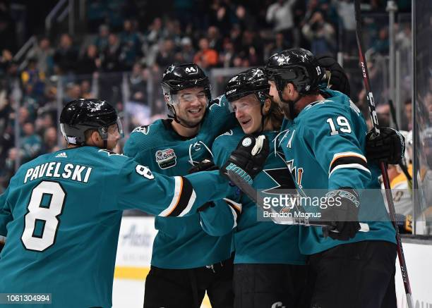 Joe Pavelski MarcEdouard Vlasic Marcus Sorensen and Joe Thornton of the San Jose Sharks celebrate scoring a goal against the Nashville Predators at...