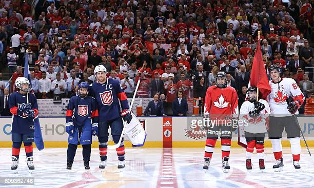 Joe Pavelski of Team USA exchanges flags with Sidney Crosby of Team Canada during the World Cup of Hockey 2016 at Air Canada Centre on September 20,...