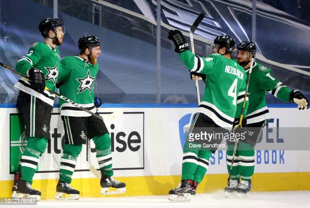 Joe Pavelski of the Dallas Stars celebrates with Jamie Oleksiak Miro Heiskanen and Andrew Cogliano after Pavelski scored in the second period of Game...