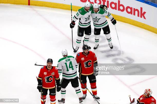 Joe Pavelski of the Dallas Stars celebrates with Tyler Seguin after scoring a goal on Cam Talbot of the Calgary Flames during the first period in...