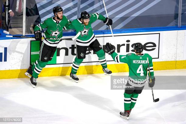 Joe Pavelski of the Dallas Stars is congratulated by Jamie Oleksiak and Miro Heiskanen after scoring a goal against the Vegas Golden Knights during...