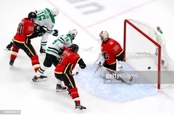 Joe Pavelski of the Dallas Stars scores a goal on Cam Talbot of the Calgary Flames during the first period in Game Four of the Western Conference...