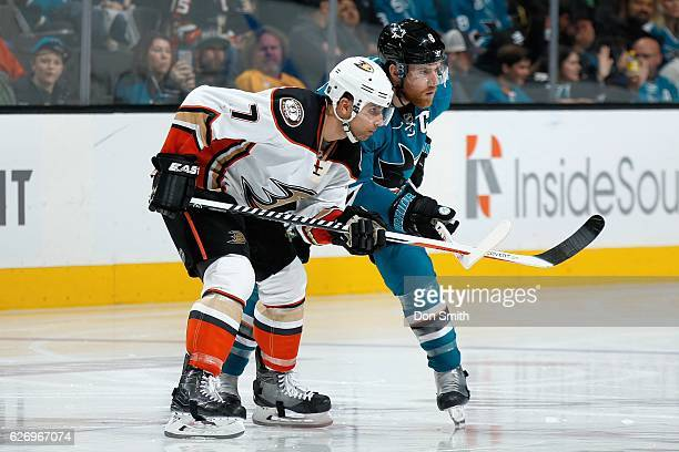 Joe Pavelski of the San Jose Sharks and Andrew Cogliano of the Anaheim Ducks look on during a NHL game at SAP Center at San Jose on November 26 2016...