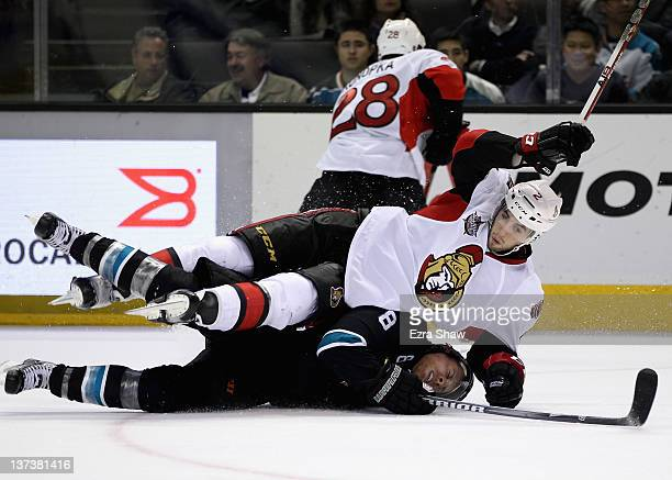 Joe Pavelski of the San Jose Sharks and Jared Cowen of the Ottawa Senators collide during their third period of their game at HP Pavilion at San Jose...