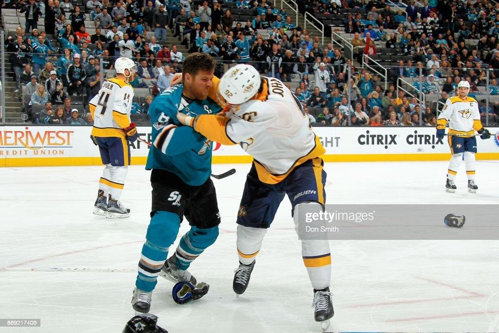 Joe Pavelski #8 of the San Jose Sharks and Ryan Johansen #92 of the Nashville Predators scuffle at SAP Center on November 1, 2017 in San Jose, California.