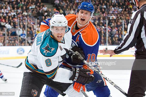Joe Pavelski of the San Jose Sharks and Shawn Horcoff of the Edmonton Oilers fight for position at Rexall Place on November 27 2009 in Edmonton...