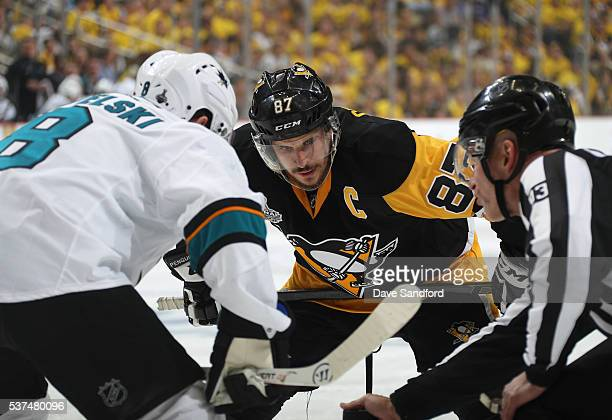 Joe Pavelski of the San Jose Sharks and Sidney Crosby of the Pittsburgh Penguins take a faceoff during the second period of Game Two of the 2016 NHL...