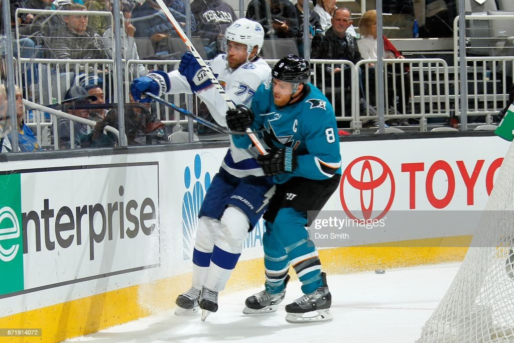 Joe Pavelski #8 of the San Jose Sharks and Victor Hedman #77 of the Tampa Bay Lightning battle along the boards at SAP Center on November 8, 2017 in San Jose, California.