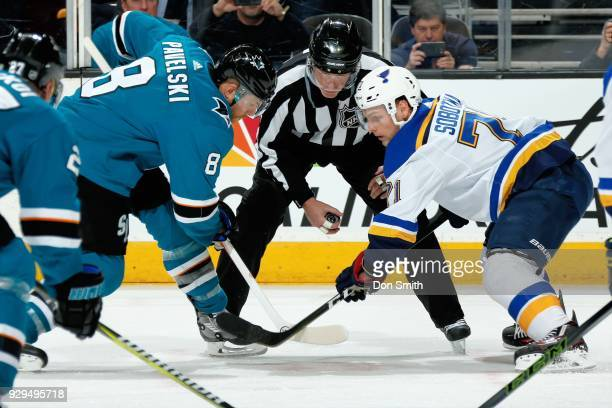 Joe Pavelski of the San Jose Sharks and Vladimir Sobotka of the St Louis Blues faceoff at SAP Center on March 8 2018 in San Jose California