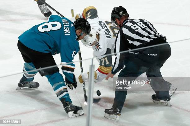 Joe Pavelski of the San Jose Sharks and William Karlsson of the Vegas Golden Knights faceoff in Game Six of the Western Conference Second Round...
