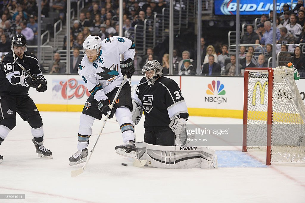 Joe Pavelski #8 of the San Jose Sharks attempts to deflect a shot past Jonathan Quick #32 of the Los Angeles Kings in Game Four of the First Round of the 2014 NHL Stanley Cup Playoffs at Staples Center on April 24, 2014 in Los Angeles, California.