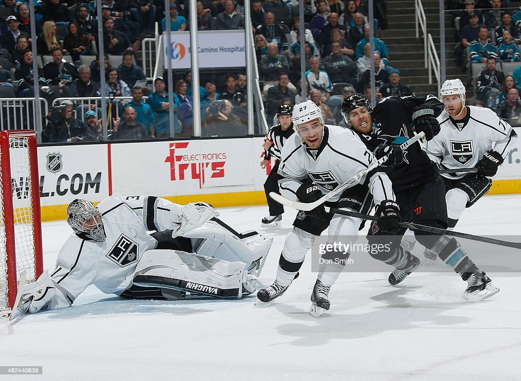 Joe Pavelski #8 of the San Jose Sharks battles for the puck against Martin Jones #31 and Alec Martinez #27 of the Los Angeles Kings during an NHL game on April 3, 2014 at SAP Center in San Jose, California.