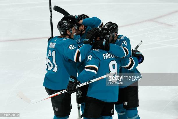 Joe Pavelski of the San Jose Sharks celebrates his first period goal against the Dallas Stars with teammates at SAP Center on February 18 2018 in San...