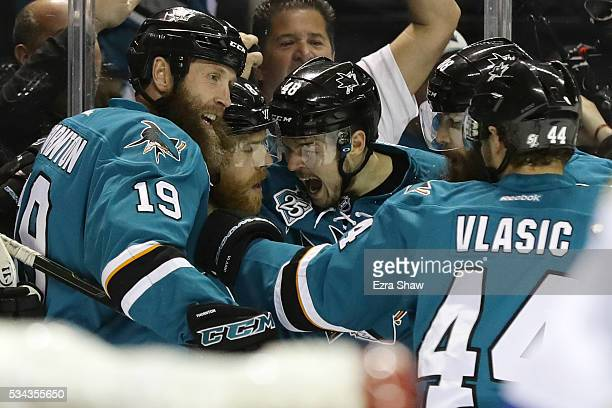 Joe Pavelski of the San Jose Sharks celebrates his goal against the St. Louis Blues with Joe Thornton, Brent Burns, Tomas Hertl and Marc-Edouard...