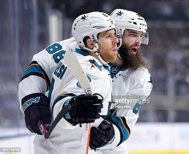 Joe Pavelski of the San Jose Sharks celebrates his goal with Brent Burns to take a 10 lead over the Los Angeles Kings during the first period in Game...