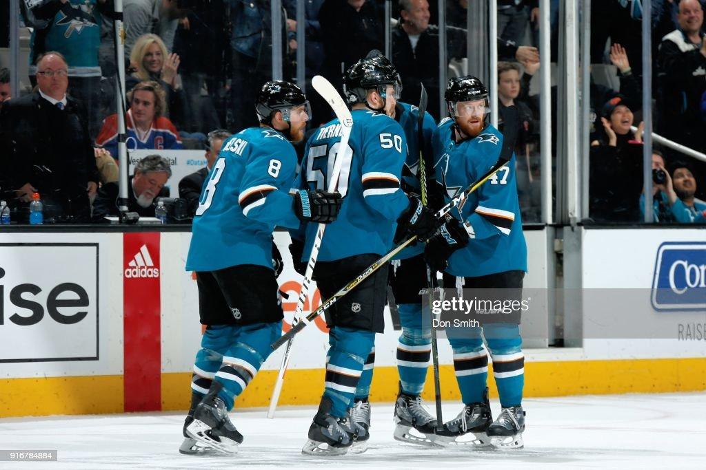 Joe Pavelski #8 of the San Jose Sharks celebrates his third period goal against the Edmonton Oilers with teammates Chris Tierney #50 and Joakim Ryan #47 at SAP Center on February 10, 2018 in San Jose, California.