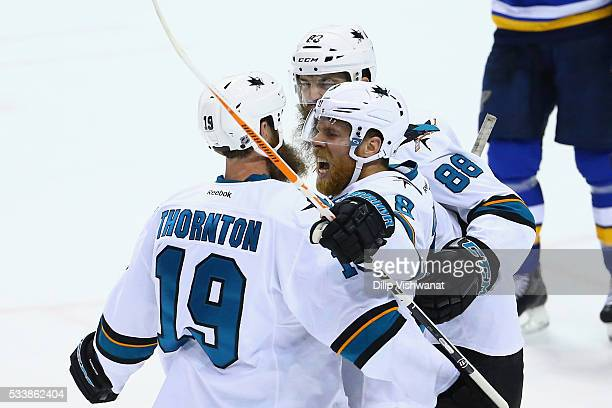 Joe Pavelski of the San Jose Sharks celebrates with Joe Thornton and Brent Burns after scoring a second period goal against the St Louis Blues in...