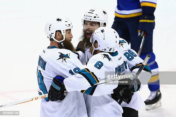 Joe Pavelski of the San Jose Sharks celebrates with Joe Thornton and Brent Burns after scoring a second period goal against the St. Louis Blues in...