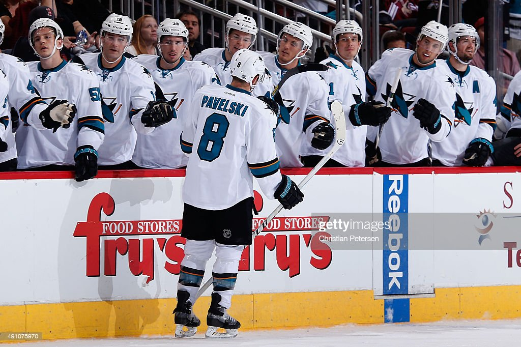 Joe Pavelski #8 of the San Jose Sharks celebrates with teammates on the bench after scoring a third period goal against the Arizona Coyotes during the NHL preseason game at Gila River Arena on October 2, 2015 in Glendale, Arizona. The Sharks defeated the Coyotes 3-0.