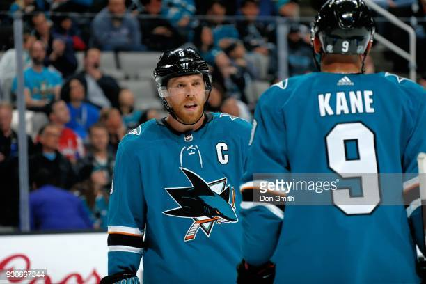 Joe Pavelski of the San Jose Sharks chats with teammate Evander Kane during a NHL game against the Washington Capitols at SAP Center on March 10 2018...