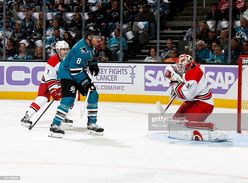Joe Pavelski #8 of the San Jose Sharks crashes the net against Ryan Murphy #7 and Eddie Lack #31 of the Carolina Hurricanes during a NHL game at the SAP Center at San Jose on October 24, 2015 in San Jose, California.