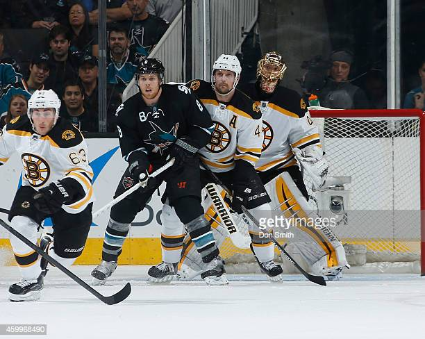 Joe Pavelski of the San Jose Sharks creates traffic in front of the net against Tuukka Rask and Dennis Seidenberg of the Boston Bruins during an NHL...