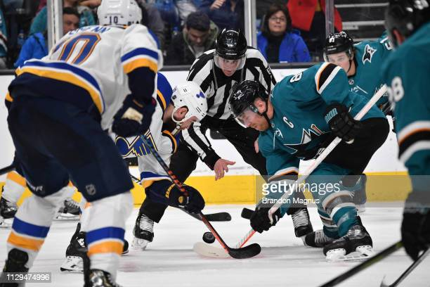 Joe Pavelski of the San Jose Sharks faces off against Ryan O'Reilly of the St Louis Blues at SAP Center on March 9 2019 in San Jose California