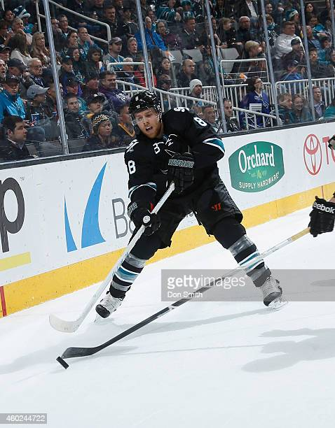 Joe Pavelski of the San Jose Sharks handles the puck against the Boston Bruins during an NHL game on December 4, 2014 at SAP Center in San Jose,...