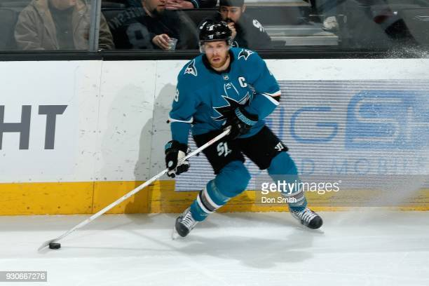 Joe Pavelski of the San Jose Sharks handles the puck during a NHL game against the Washington Capitols at SAP Center on March 10 2018 in San Jose...