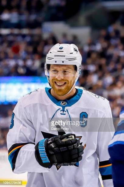 Joe Pavelski of the San Jose Sharks is all smiles as he looks on during a third period stoppage in play against the Winnipeg Jets at the Bell MTS...
