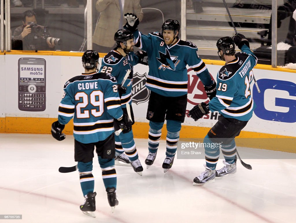 Joe Pavelski #8 of the San Jose Sharks is congratulated by teammates after he scored a goal in the third period to give the Sharks a 4-2 lead over the Detroit Red Wings in Game One of the Western Conference Semifinals during the 2010 NHL Stanley Cup Playoffs at HP Pavilion on April 29, 2010 in San Jose, California.