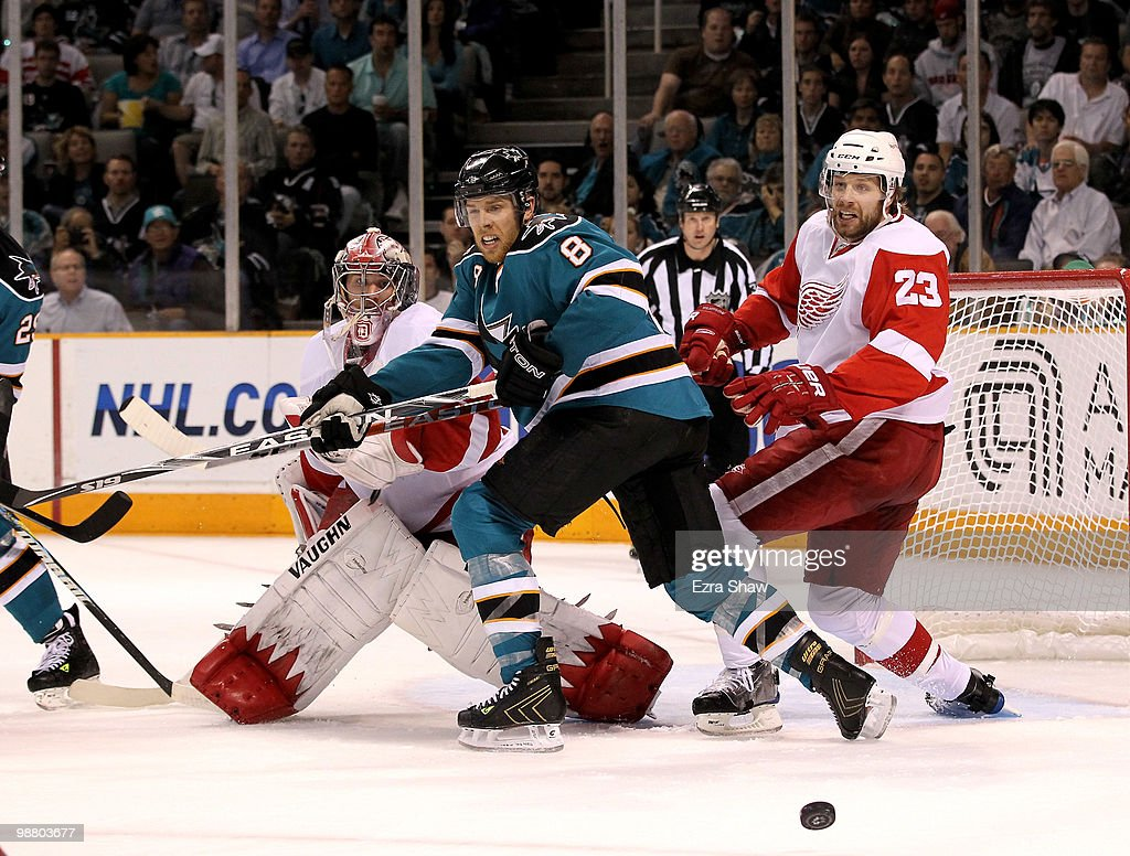 Joe Pavelski #8 of the San Jose Sharks is defended by Brad Stuart #23 and goalie Jimmy Howard #35 of the Detroit Red Wings in Game Two of the Western Conference Semifinals during the 2010 NHL Stanley Cup Playoffs at HP Pavilion on May 2, 2010 in San Jose, California.