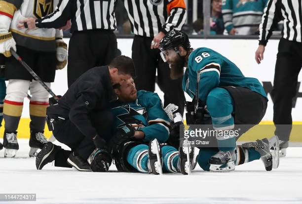 Joe Pavelski of the San Jose Sharks is looked on after a hard hit by the Vegas Golden Knights in the third period in Game Seven of the Western...