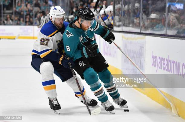Joe Pavelski of the San Jose Sharks keeps the puck away from Alex Pietrangelo of the St Louis Blues at SAP Center on November 17 2018 in San Jose...