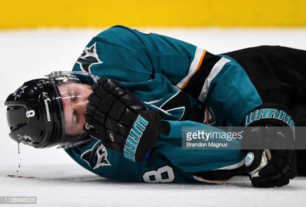 Joe Pavelski of the San Jose Sharks lies on ice after being hit in the head against the Vegas Golden Knights in Game Seven of the Western Conference...