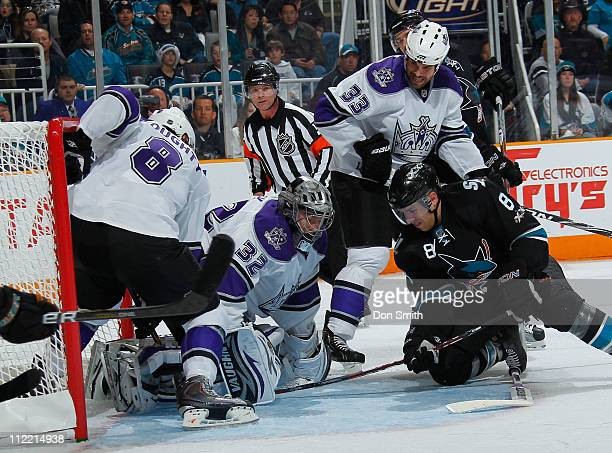 Joe Pavelski of the San Jose Sharks looks for a rebound against Drew Doughty, Jonathan Quick, and Willie Mitchell of the Los Angeles Kings in Game 1...