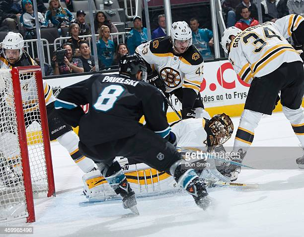 Joe Pavelski of the San Jose Sharks looks for a rebound against Tuukka Rask of the Boston Bruins during an NHL game on December 4, 2014 at SAP Center...