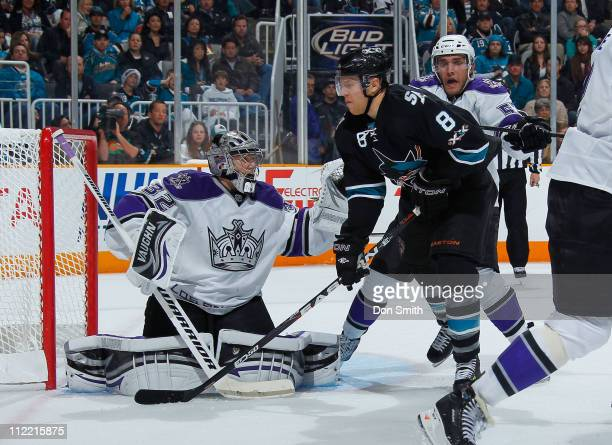 Joe Pavelski of the San Jose Sharks looms in front of the net against Jonathan Quick and Alec Martinez of the Los Angeles Kings in Game 1 of the...