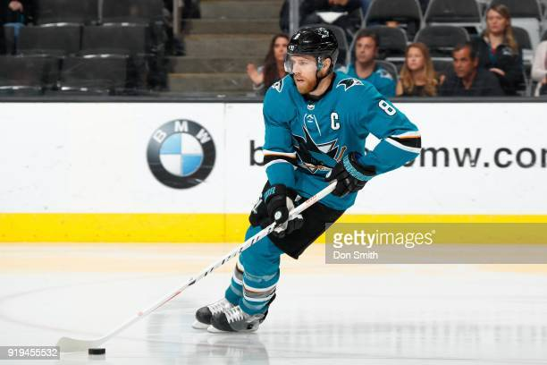 Joe Pavelski of the San Jose Sharks moves the puck during a NHL game against the Arizona Coyotes at SAP Center on February 13 2018 in San Jose...
