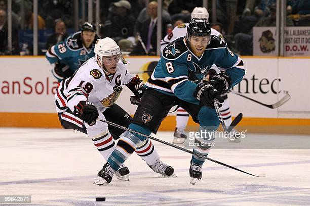 Joe Pavelski of the San Jose Sharks moves the puck in front of Jonathan Toews of the Chicago Blackhawks in Game One of the Western Conference Finals...