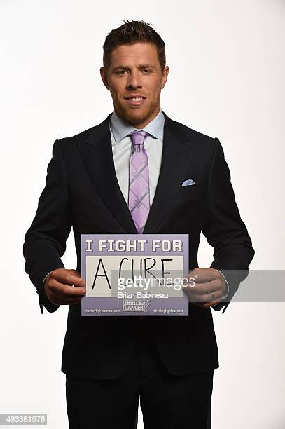 Joe Pavelski of the San Jose Sharks poses for a portrait at the NHL Player Media Tour at the Ritz Carlton on September 8 2015 in Toronto Ontario