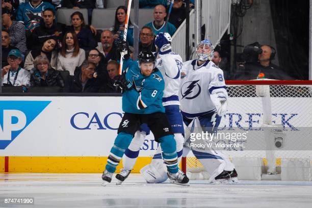 Joe Pavelski of the San Jose Sharks positions in front of Braydon Coburn and Andrei Vasilevskiy of the Tampa Bay Lightning at SAP Center on November...