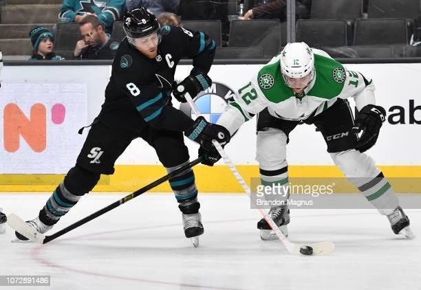 Joe Pavelski of the San Jose Sharks protects the puck against Radek Faksa of the Dallas Stars at SAP Center on December 13 2018 in San Jose California