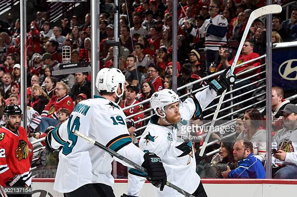 Joe Pavelski of the San Jose Sharks reacts after scoring against the Chicago Blackhawks in the second period of the NHL game at the United Center on...